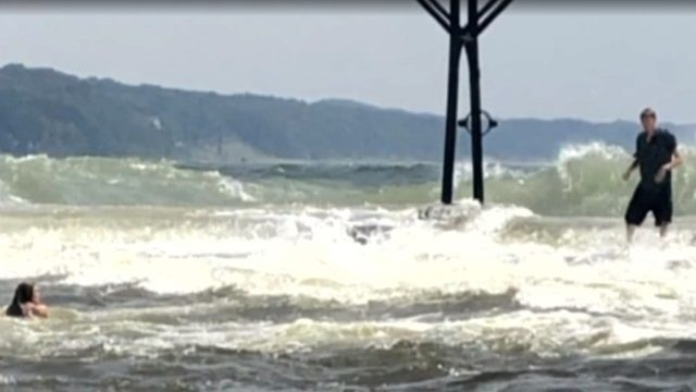 VIDEO: Boaters rescue teen swept off pier into Lake Michigan