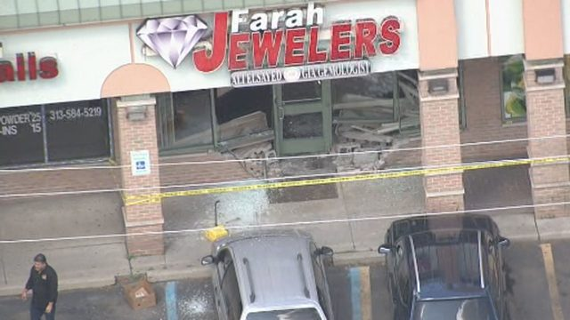 Minivan smashes through front of jewelry store at Dearborn shopping center