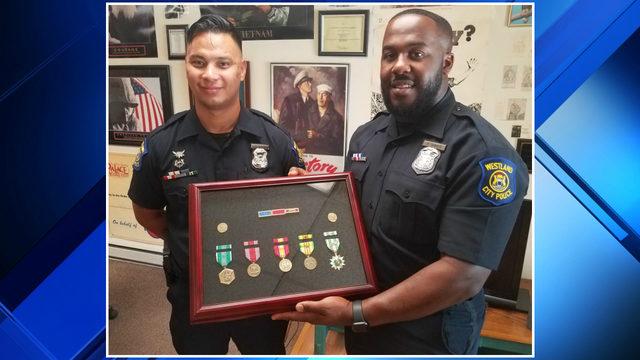Westland police officer spends months tracking down medals to replace…