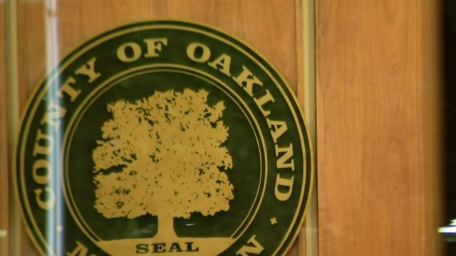 Employee covers Oakland County board chambers in essential oil to ward…