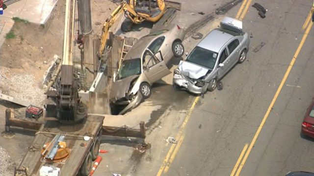 Two cars damaged, one lands in construction zone hole in crash on…