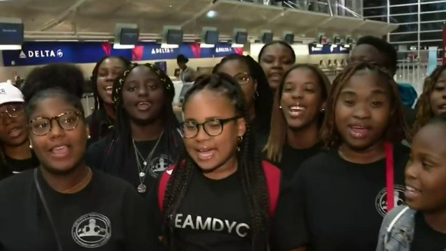 Detroit Youth Choir sings at airport before leaving for Los Angeles