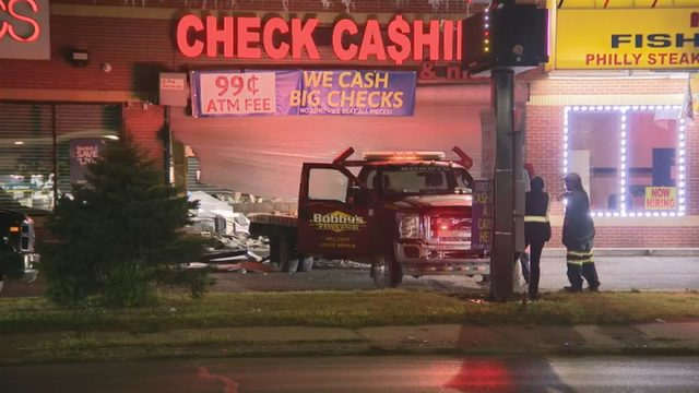 Carjacked tow truck used by thieves to smash into Detroit check cashing…