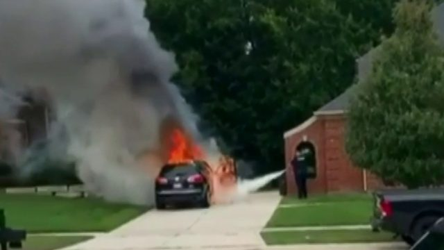 SUV burns in Shelby Township driveway