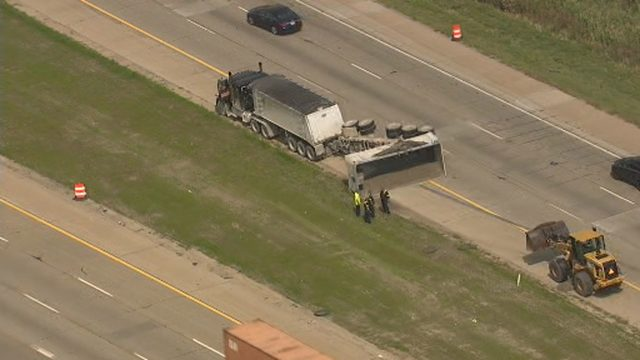 Northbound I-75 down to one lane at Sibley Road due to overturned gravel hauler