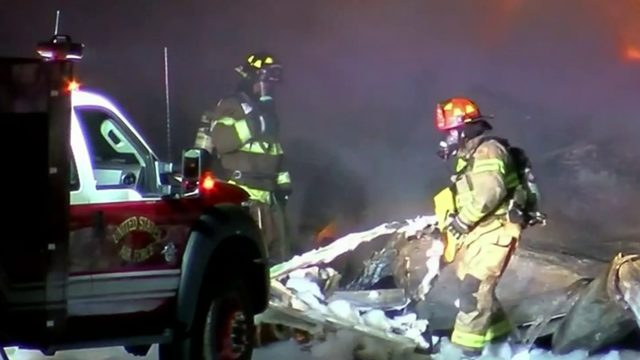 2 killed after cargo plane crashes into Toledo auto repair business