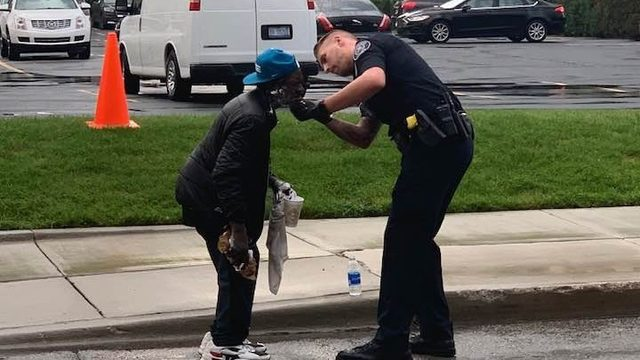 Detroit police officer helps man shave outside Comerica Park