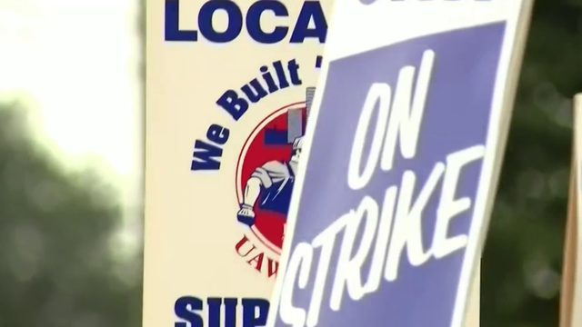 GM moves striking UAW members to COBRA healthcare coverage