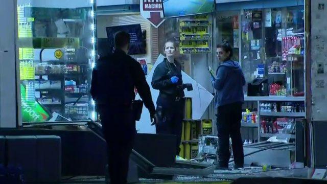 Truck crashes into Detroit gas station; ATM stolen
