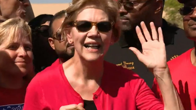Elizabeth Warren protests with striking UAW members at…