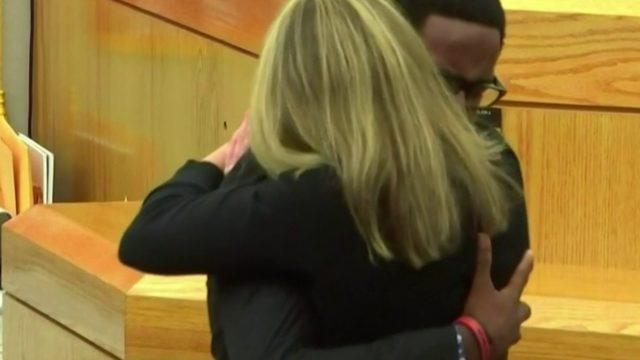Slain man's brother and judge hug cop sentenced to 10 years