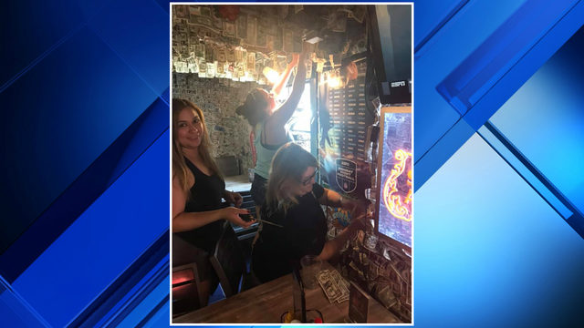 Florida bar donates thousands of dollars that decorated walls to help…