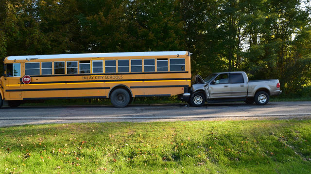Pickup truck driver dies after crashing into back of stopped school bus…