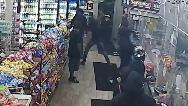 VIDEO: Man fires liquor bottle into TV at Detroit liquor store